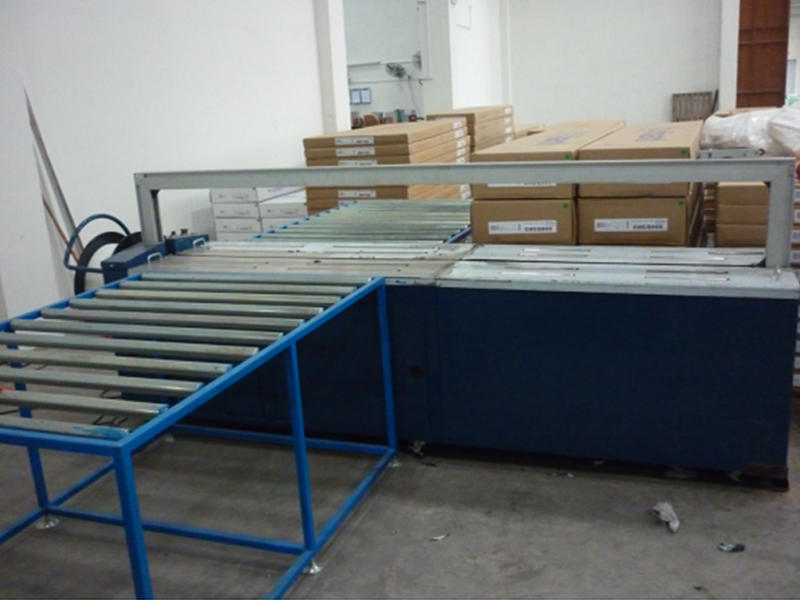Packing and taping machine