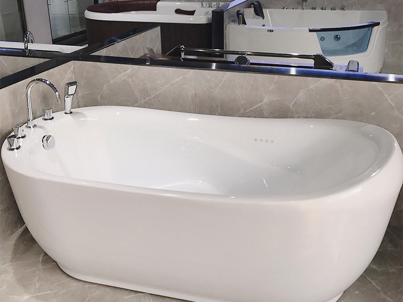 on modern freestanding bath with waterfall for apartment